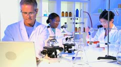 Laboratory Technicians Checking Wireless Tablet Results Stock Footage