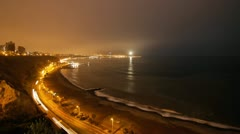 Lima coastline light up at night by cars Stock Footage