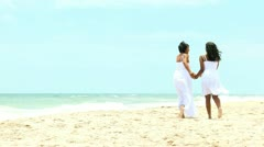 African American Mother Teenage Daughter Walking Beach - stock footage