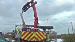 Truck Unloading Telegraph Poles Stock Footage