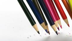 Color pencils falling on white paper, Slow Motion Stock Footage