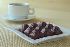 cup of coffee and chocolate candies - stock photo