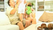 Happy Young Family Playing Together Home Couch Stock Footage