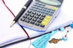 Calculator, pen and notebook Stock Photos