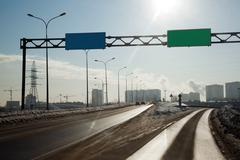 the road to the entrance to the metropolis - stock photo