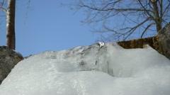 Park stream waterfall cascade ice sulight water blue sky Stock Footage