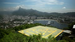 Helicopter hoovers over landing pad near Rio de Janeiro, Brazil Stock Footage