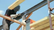 Roofing works - welder on scaffold Stock Footage