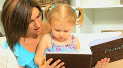 Young Mom Daughter with Photo Album Close Up Stock Footage
