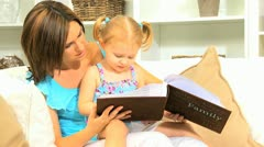 Mother Daughter Enjoying Photograph Album - stock footage