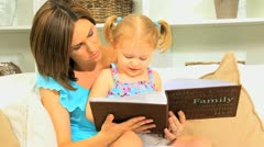 Young Mother Daughter with Photo Album Stock Footage