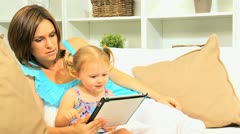 Little Girl Playing Digital Games with Mother Stock Footage