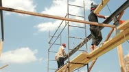 Roofing works - builders on scaffolds Stock Footage
