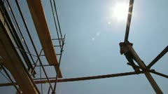 Roofing works - worker on scaffold Stock Footage