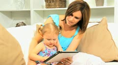 Pre School Girl Parent Using Wireless Tablet Stock Footage
