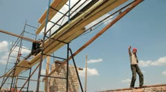 Roofing works - workers on scaffold Stock Footage