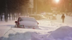The strong snow cyclone in the city (sunset): difficult traffic,extreme frost! - stock footage