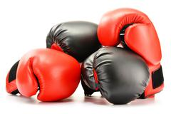 two pairs of leather boxing gloves isolated on white - stock photo