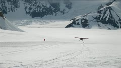 Plane landing on glacier Stock Footage