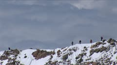 Climbers on west ridge with sea of clouds - stock footage