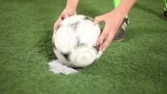 Forward (football player) carefully installs soccer-ball on a penalty spot Stock Footage