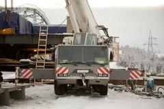 100 ton crane at the construction of the bridge Stock Photos