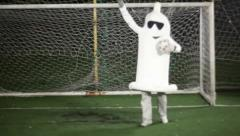 Crazy condom ラ man in costume acting as a goalkeeper saving goal Stock Footage