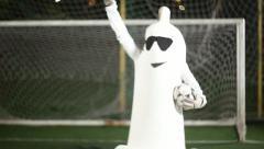 Condom man kicks a ball. Stock Footage