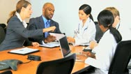 Stock Video Footage of Multi Ethnic Medical Team Meeting Success