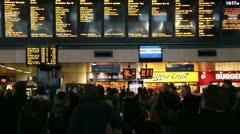 Commuters and travellers at euston railway station Stock Footage