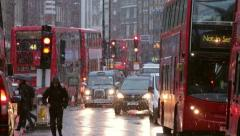 Busy london traffic in the snow at dusk in winter Stock Footage
