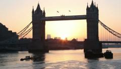 tilting clip from water to sky of london tower bridge at sunrise - stock footage