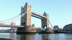 Red london bus crosses tower bridge, england Stock Footage