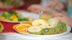Sliced ​​fruit on a plate. Stock Footage
