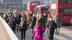Early morning commuters cross london bridge Stock Footage