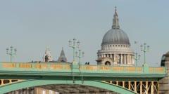 London bus passes over southwark bridge Stock Footage
