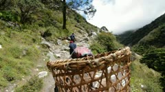 Porters headed up trail Stock Footage