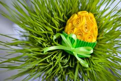 Decorated easter egg in the grass - stock photo