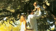 Proud Young Couple with Baby Outdoors Sunshine Stock Footage