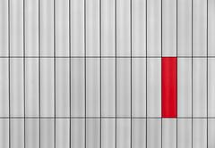 gray outside wall with a red rectangle - stock photo