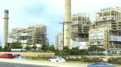 Traffic On PCH Passing Old Huntington Beach Electric Power Plant Stock Footage