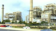 Stock Video Footage of Traffic On PCH Passing Old Huntington Beach Electric Power Plant