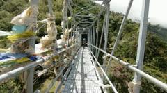 Passing porters on the bridge Stock Footage
