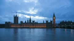 illuminated houses of parliament at night, london, england - stock footage