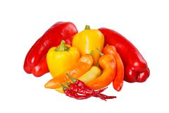 Group of ripe, hot and mild peppers isolated against white Stock Photos