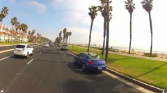 Driving PCH Past Huntington Beach Condos And Beach Park Stock Footage