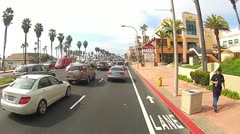 POV Car Driving PCH Past Huntington Beach Shops, Restaurants Stock Footage