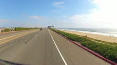 POV Car Driving PCH Past North Huntington Beach Stock Footage