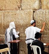 Jerusalem, israel - march 03: jewish worshipers  pray at the wailing wall an Stock Photos