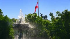 Austrian flag with fountain in park Stock Footage